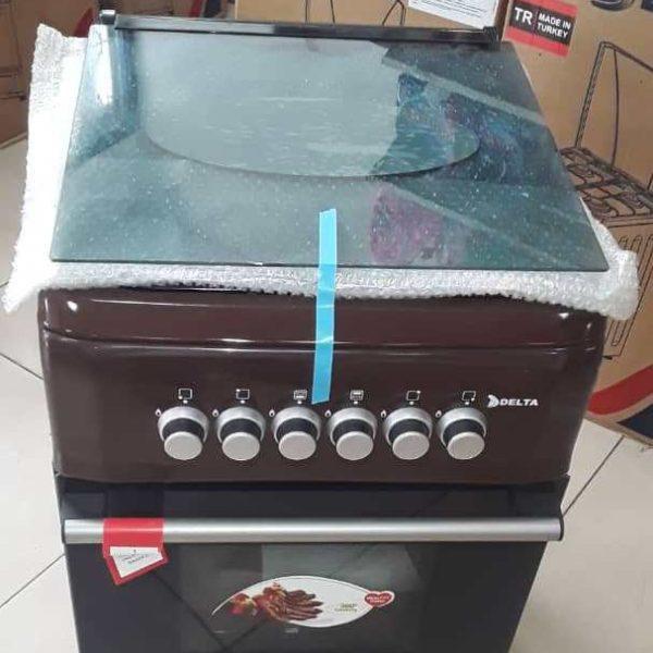 DELTA-Cuisinière à Gaz 4 Foyers 50x60cm - Inox recouvert d'émail- 12mois de garantie